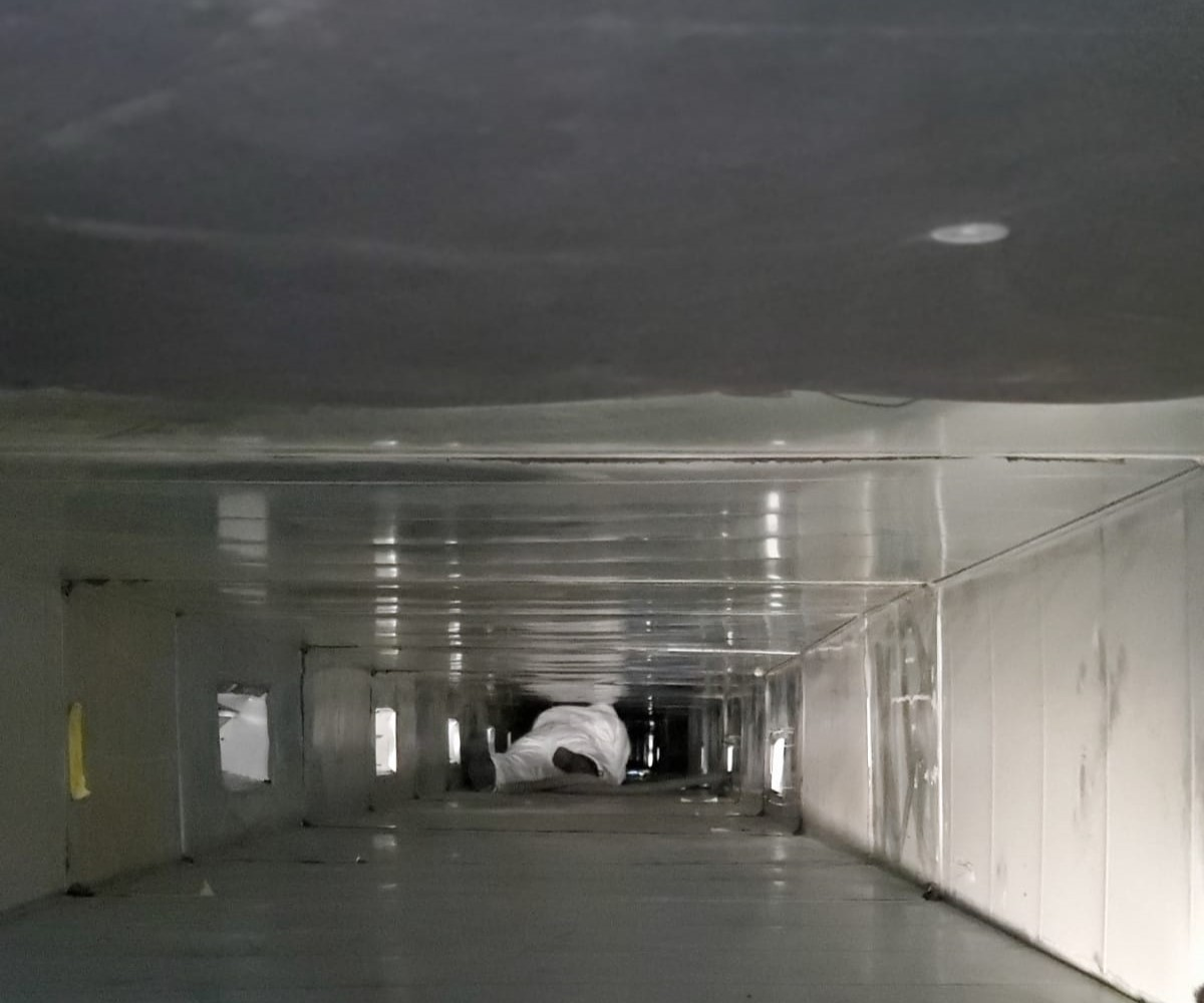 Man inside of ducts for commercial air duct cleaning in Newark, NJ